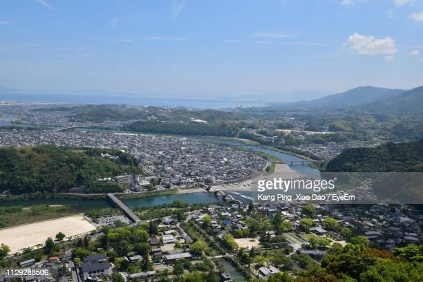 high angle view of buildings and sea against sky - 山口県 ストックフォトと画像