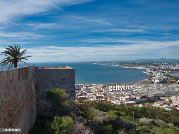 high angle view of buildings and sea against sky - tunisia stock pictures, royalty-free photos & images