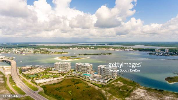 high angle view of buildings and sea against sky - gulf coast states stock pictures, royalty-free photos & images