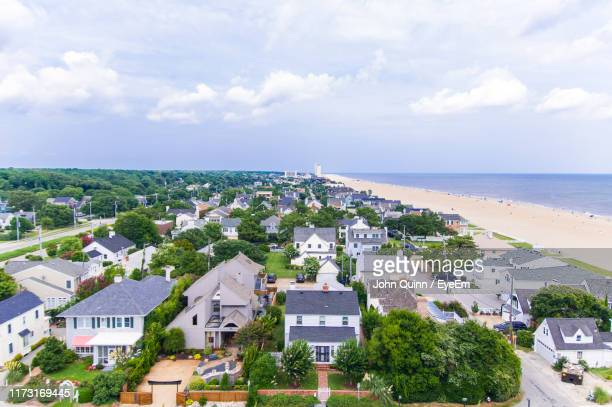 high angle view of buildings and sea against sky - virginia beach foto e immagini stock