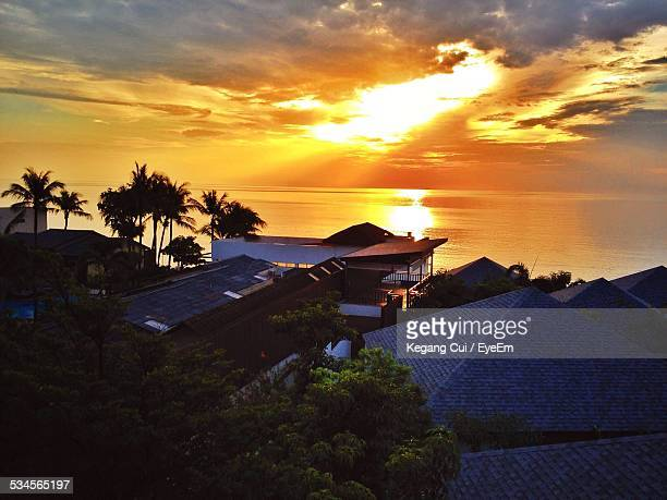 High Angle View Of Buildings And Sea During Sunset