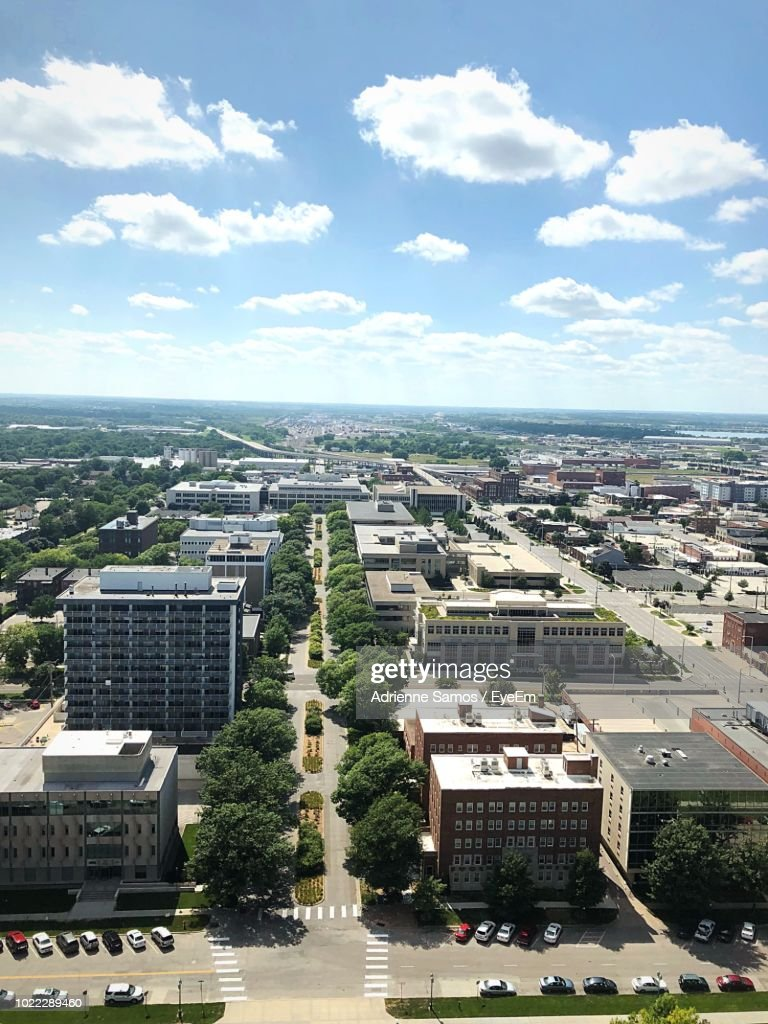 High Angle View Of Buildings And Trees Against Sky : Stock Photo