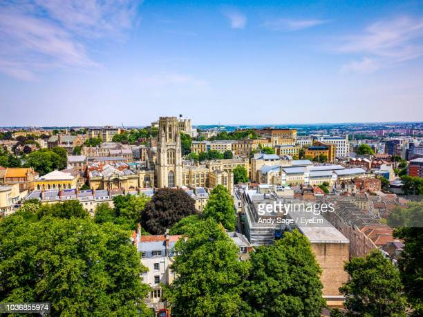high angle view of buildings and trees against sky - bristol stock pictures, royalty-free photos & images