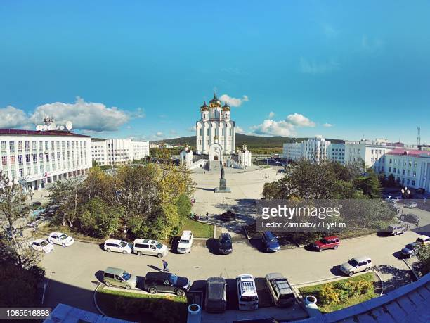 high angle view of buildings and trees in city against sky - fedor stock pictures, royalty-free photos & images