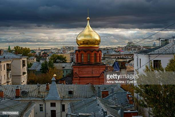 high angle view of buildings at red square against cloudy sky - nikitina stock pictures, royalty-free photos & images