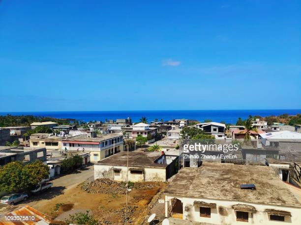 high angle view of buildings by sea against blue sky - comores photos et images de collection