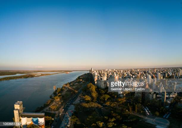 high angle view of buildings by sea against clear sky - argentinien stock-fotos und bilder