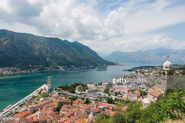 High Angle View Of Buildings By Sea Against Sky At Kotor