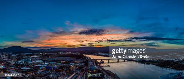high angle view of buildings by sea against sky during sunset - chattanooga stock pictures, royalty-free photos & images