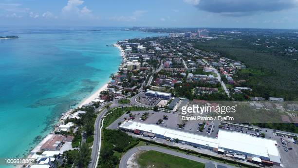 high angle view of buildings by sea against sky - cable beach bahamas stock photos and pictures