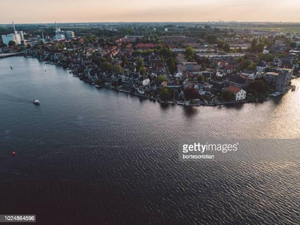 high angle view of buildings by sea against sky - bortes fotografías e imágenes de stock