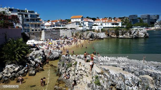 high angle view of buildings by sea against sky - cascais stock photos and pictures