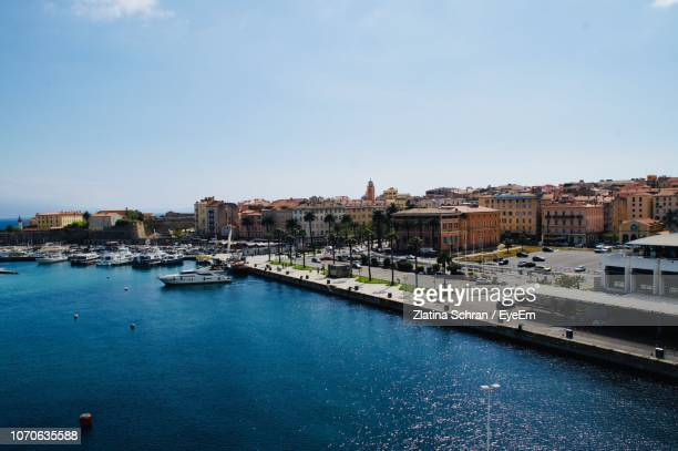 high angle view of buildings by sea against sky - ajaccio stock photos and pictures