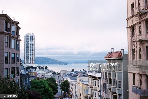 high angle view of buildings by sea against sky - brianne stock pictures, royalty-free photos & images