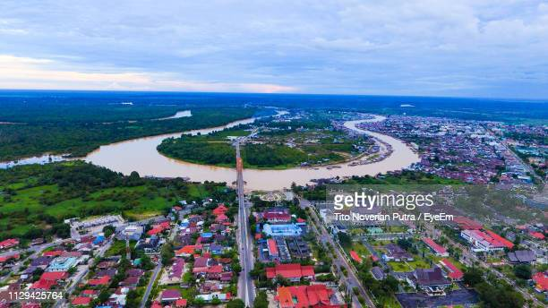 high angle view of buildings by sea against sky - central kalimantan stock pictures, royalty-free photos & images