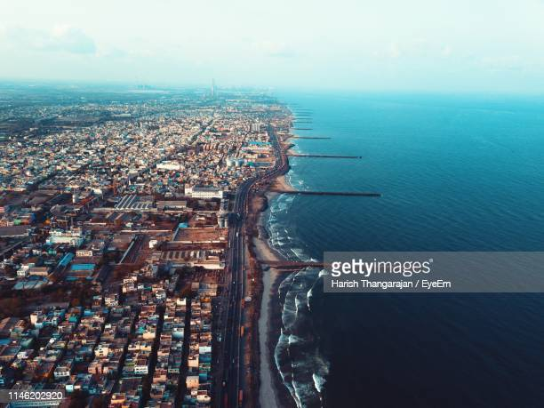 high angle view of buildings by sea against sky - tamil nadu stock pictures, royalty-free photos & images