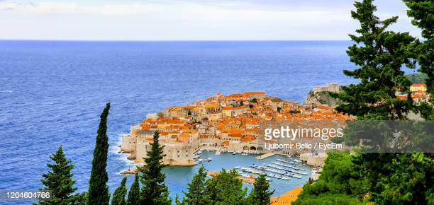 high angle view of buildings by sea against sky - ljubomir belic stock pictures, royalty-free photos & images
