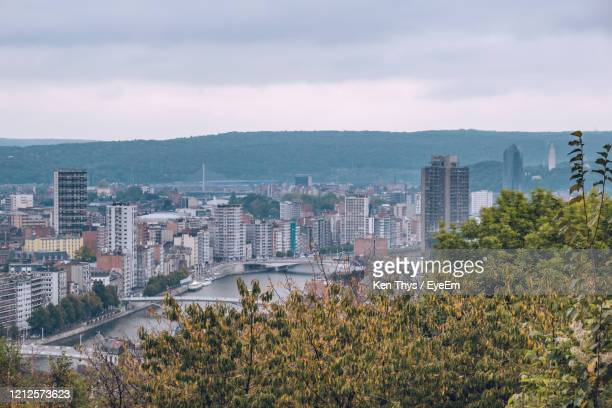 high angle view of buildings by sea against sky - liege stock pictures, royalty-free photos & images