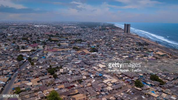 high angle view of buildings by sea against sky - ghana stock pictures, royalty-free photos & images