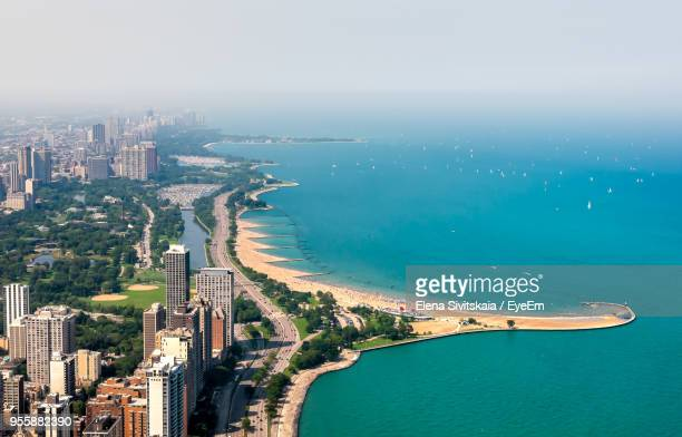 high angle view of buildings by sea against sky - lake michigan stock pictures, royalty-free photos & images