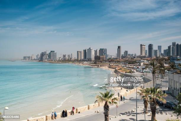 high angle view of buildings by sea against sky - tel aviv foto e immagini stock