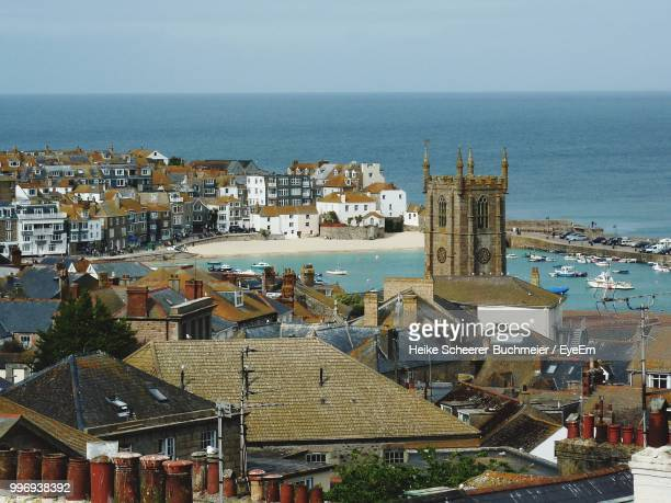high angle view of buildings by sea against sky - st ives stock pictures, royalty-free photos & images