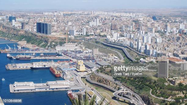 high angle view of buildings by sea in city - algeria photos et images de collection