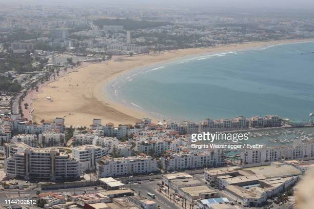 high angle view of buildings by sea - agadir stock pictures, royalty-free photos & images