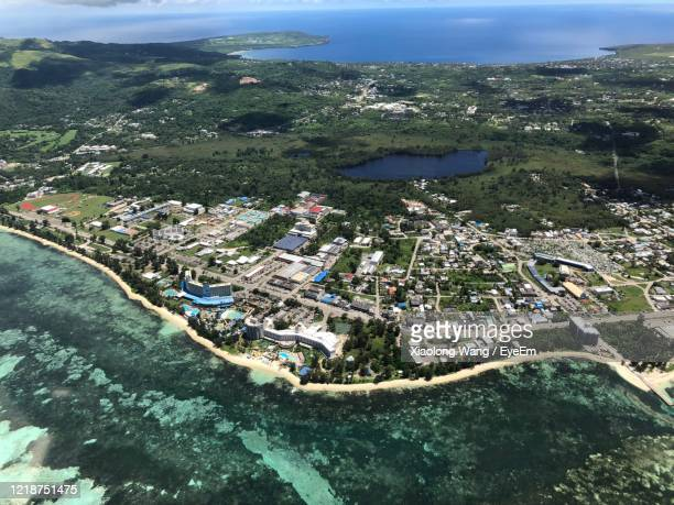 high angle view of buildings by sea - 北マリアナ諸島 ストックフォトと画像
