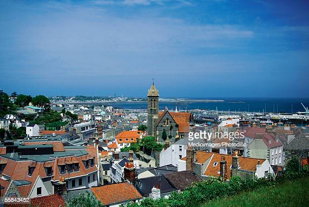 high angle view of buildings in a city, saint peter's port, guernsey, england - isola di guernsey foto e immagini stock