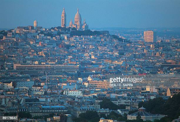 High angle view of buildings in a city with a church in the background Basilique Du Sacre Coeur Montmartre Paris France
