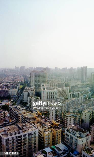 high angle view of buildings in city against clear sky - zhanjiang stock photos and pictures