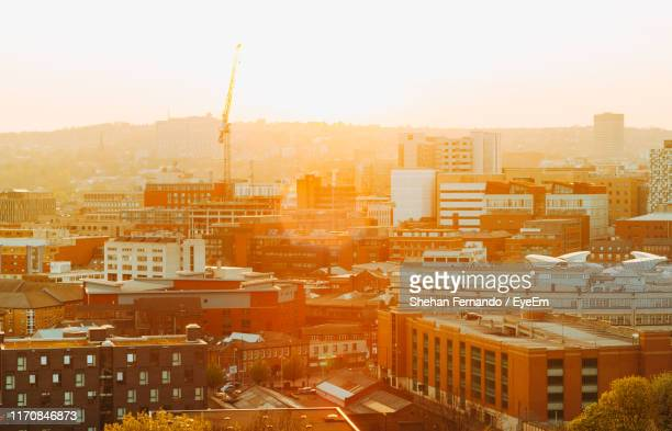high angle view of buildings in city against clear sky - sheffield stock pictures, royalty-free photos & images