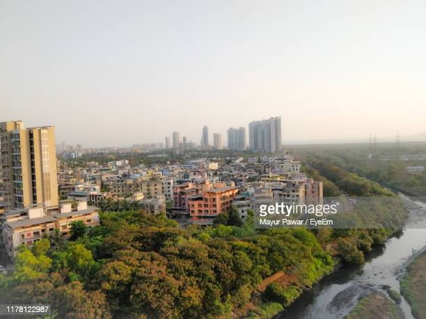 high angle view of buildings in city against clear sky - bangalore stock pictures, royalty-free photos & images