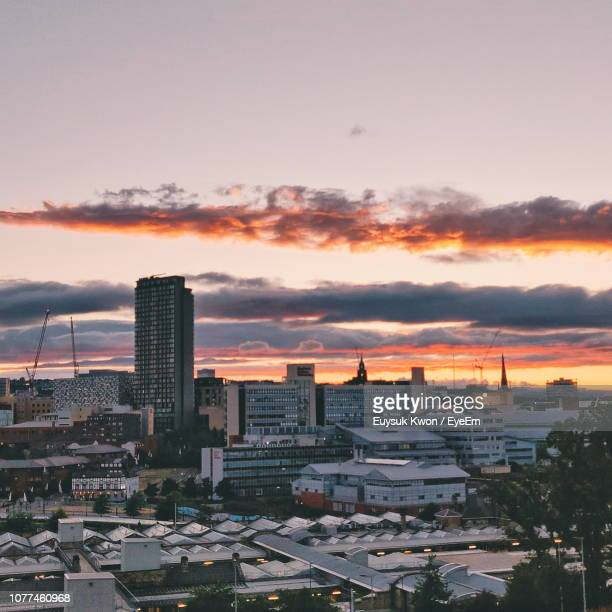 high angle view of buildings in city against sky during sunset - sheffield stock pictures, royalty-free photos & images