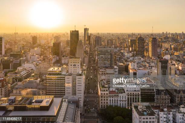 high angle view of buildings in city against sky during sunset - buenos aires stock-fotos und bilder