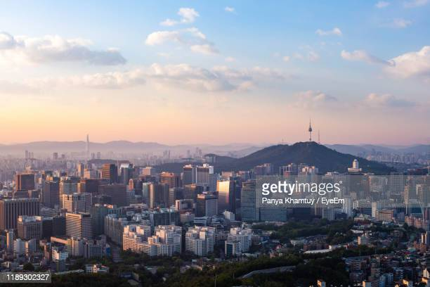 high angle view of buildings in city against sky during sunset - south korea stock pictures, royalty-free photos & images