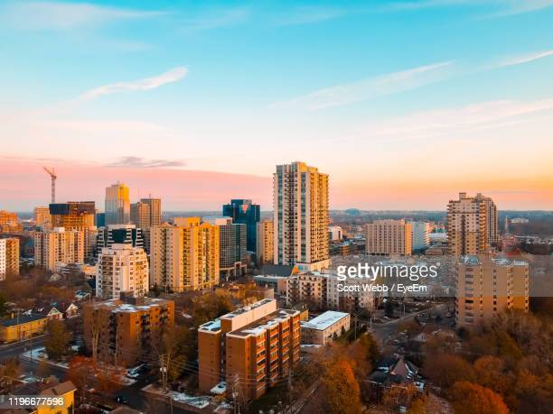 high angle view of buildings in city against sky during sunset - london ontario stock pictures, royalty-free photos & images