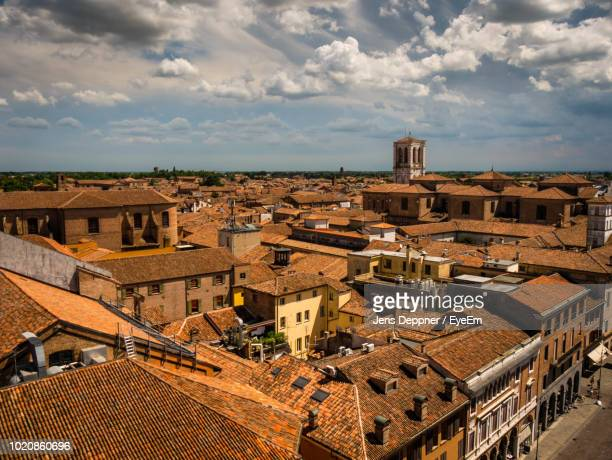 high angle view of buildings in city against sky - ferrara foto e immagini stock