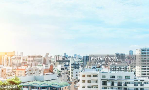 high angle view of buildings in city against sky - 昼間 ストックフォトと画像