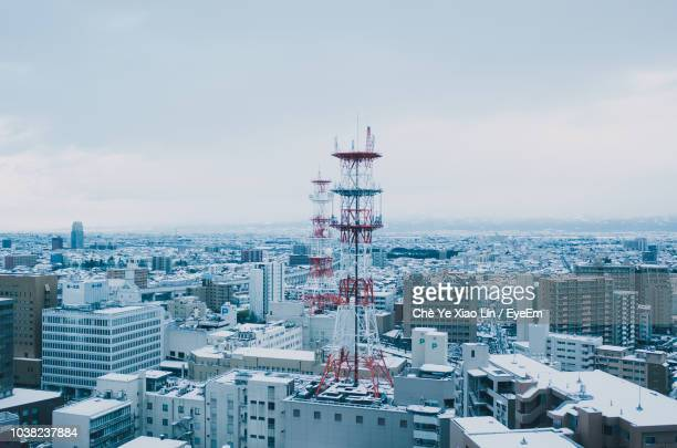 high angle view of buildings in city against sky - 富山県 ストックフォトと画像