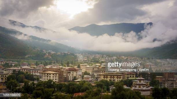 high angle view of buildings in city against sky - thimphu stock pictures, royalty-free photos & images