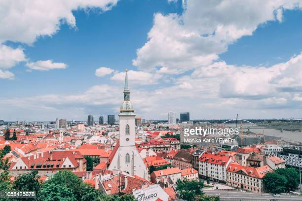 high angle view of buildings in city against sky - bratislava stock pictures, royalty-free photos & images