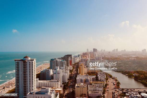 high angle view of buildings in city against sky - miami beach stock pictures, royalty-free photos & images