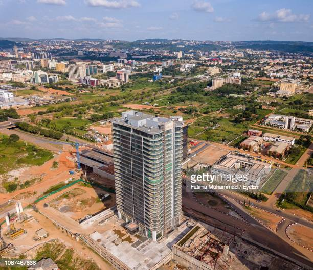 high angle view of buildings in city against sky - abuja stock pictures, royalty-free photos & images