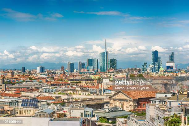 high angle view of buildings in city against sky - orizzonte urbano foto e immagini stock