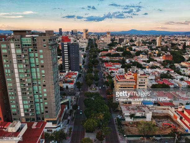 high angle view of buildings in city against sky - guadalajara mexico stock pictures, royalty-free photos & images