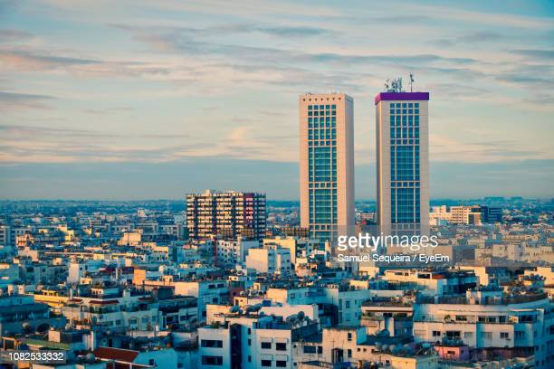 high angle view of buildings in city against sky - casablanca stock pictures, royalty-free photos & images