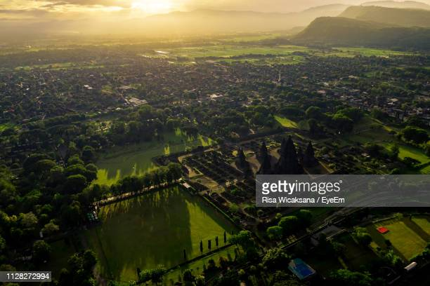 high angle view of buildings in city against sky - yogyakarta stock pictures, royalty-free photos & images