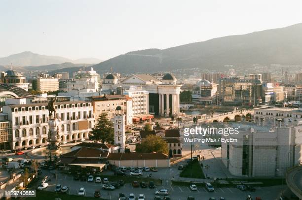 high angle view of buildings in city against sky - skopje stock pictures, royalty-free photos & images